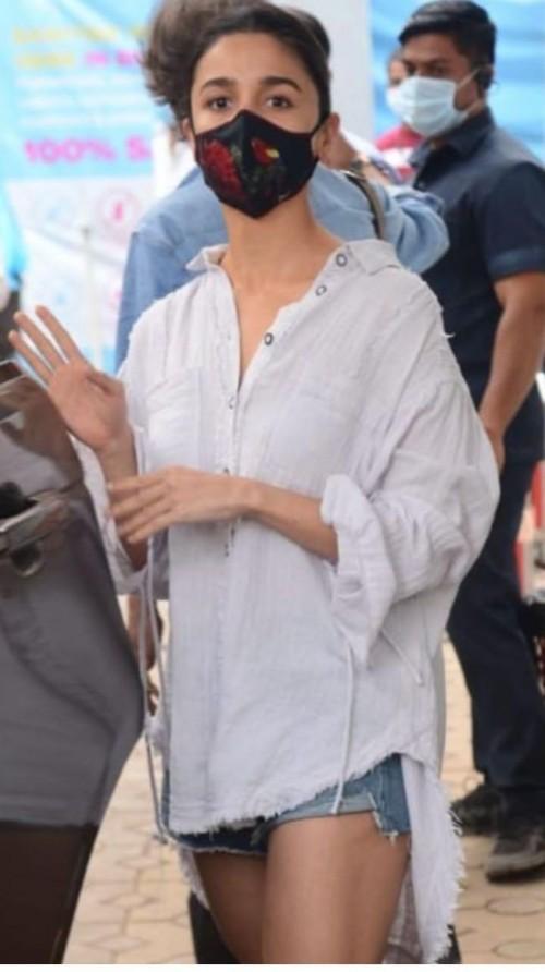 Help me look for a similar white oversized shirt online like alia bhatt - SeenIt