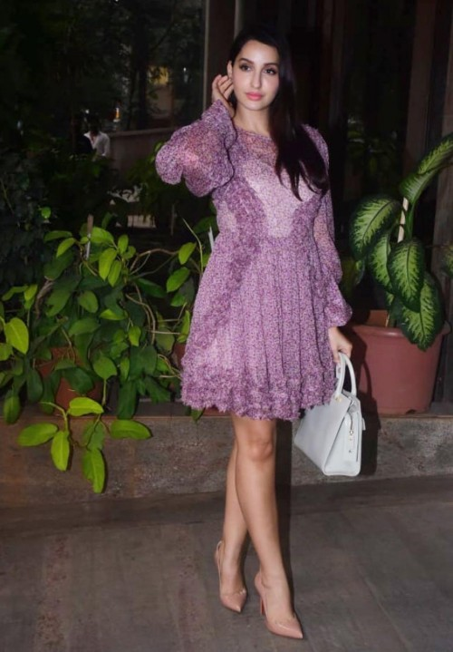 Yay or nay? Nora Fatehi seen wearing a purple casual dress - SeenIt