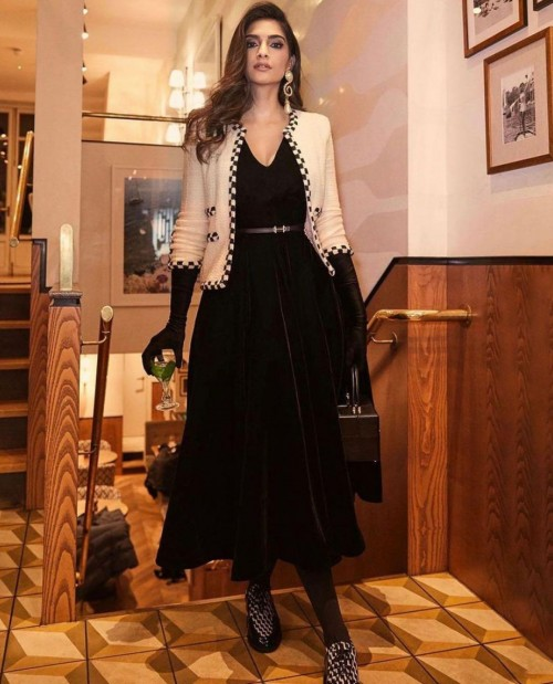 Yay or nay? Sonam Kapoor seen wearing a black midi dress with a white short jacket - SeenIt
