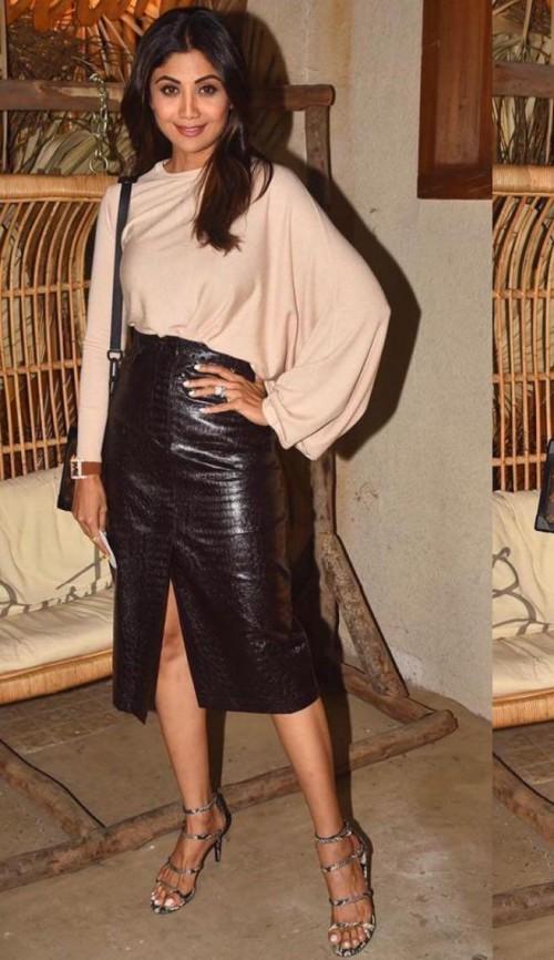 Help me find a similar black skirt like Shilpa Shetty is seen wearing - SeenIt