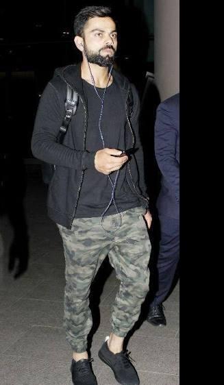 I'm looking for similar trousers,t-shirt,jacket and shoes like virat kohli - SeenIt