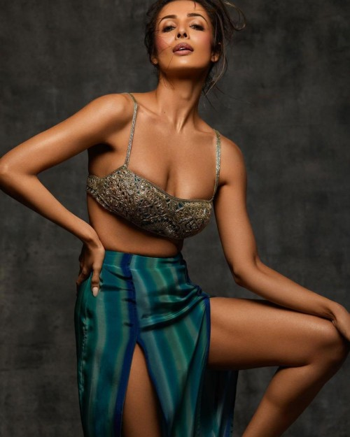 Yay or nay? Malaika Arora wearing an embroidered bustier with slit pants outfit for the Arpita Mehta shoot - SeenIt