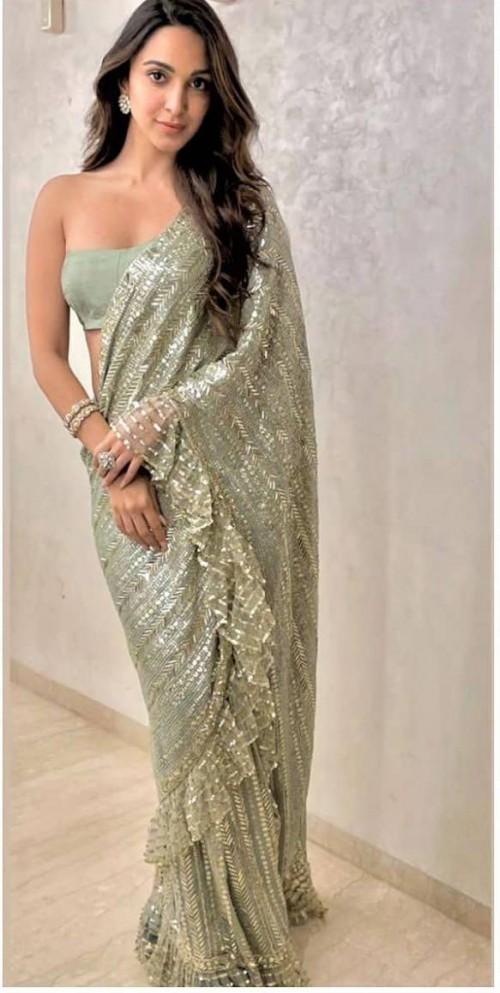 Yay or nay? Kiara Advani seen wearing a green shimmer Manish Malhotra saree - SeenIt