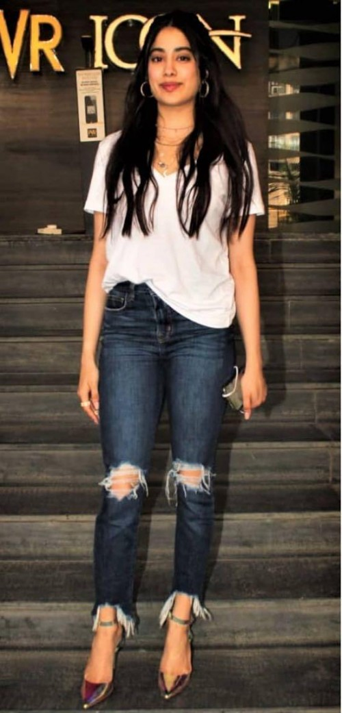 Want those cool ripped denims please like Jhanvi Kapoor is wearing - SeenIt