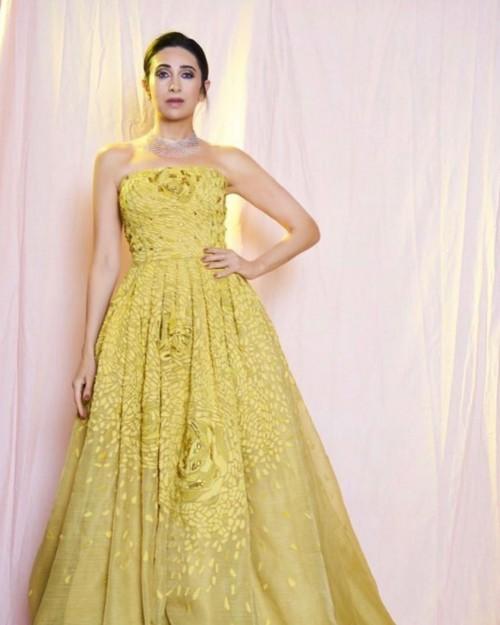 Yay or nay? Karisma kapoor seen wearing a yellow strapless Pankaj and Nidhi outfit - SeenIt