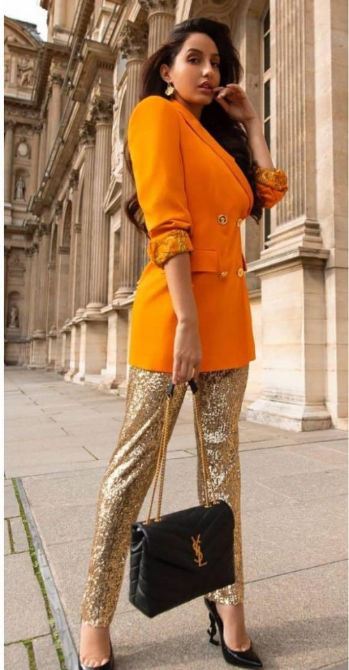 Yay or nay? Nora Fatehi seen wearing an orange Versace  blazer and sequin golden pants in dubai - SeenIt