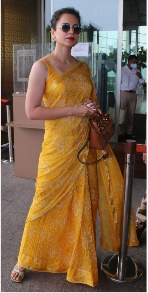 Help me find a similar yellow pattern saree - SeenIt