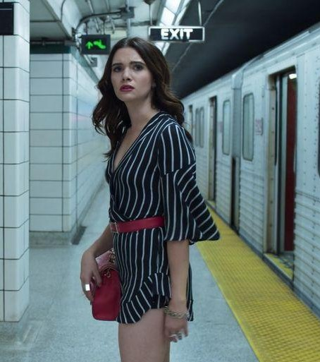help me find a similar black stripe romper and a red belt as Jane Slone from the bold type - SeenIt