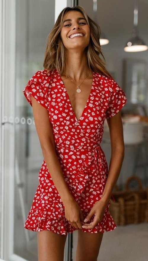 Help me find a similar red floral wrap dress - SeenIt