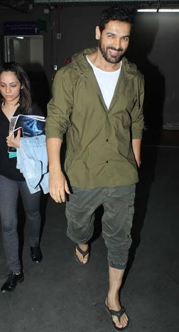 I am looking for his shirt or hood what ever john abraham is wearing here....please help - SeenIt