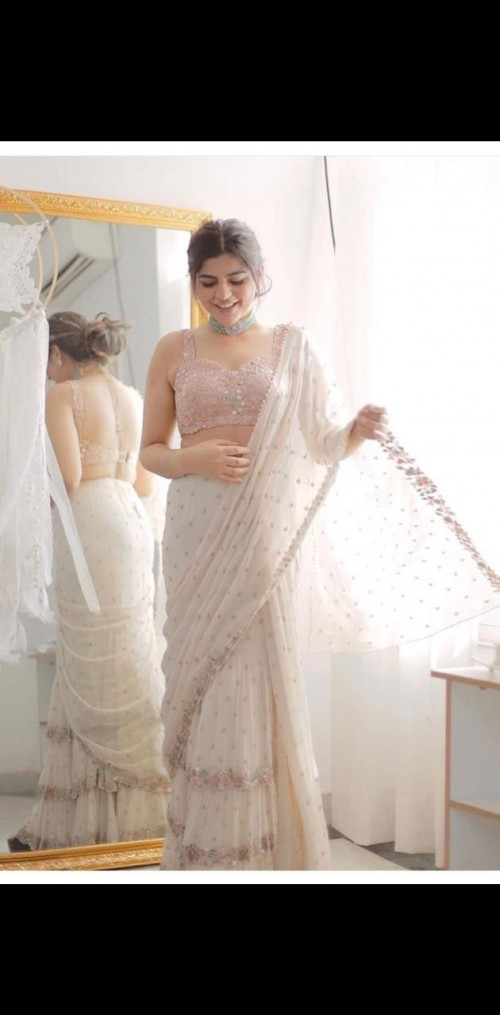 I am looking for similar white ruffle saree. - SeenIt