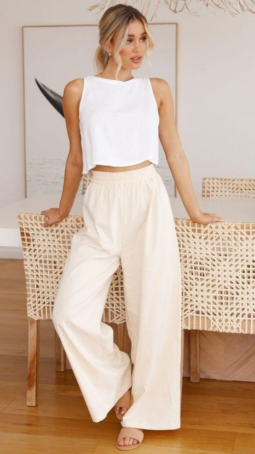 Help me find a similar white crop top and beige pants - SeenIt