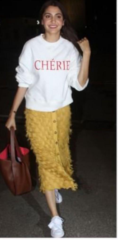 Help me find a similar white sweatshirt online like Anushka Sharma is seen wearing - SeenIt