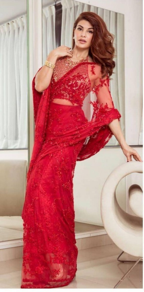 Yay or nay? Jacqueline Fernandez seen wearing a red lace net saree - SeenIt