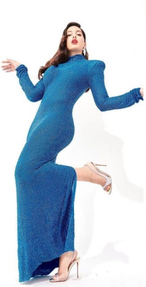 Yay or nay? Nora Fatehi seen wearing a peacock blue shimmer gown recently - SeenIt