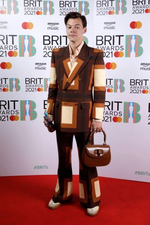 Yay or nay? Harry Styles attends the BRITS AWARDS 2021 wearing a patterned blazer pants attire - SeenIt