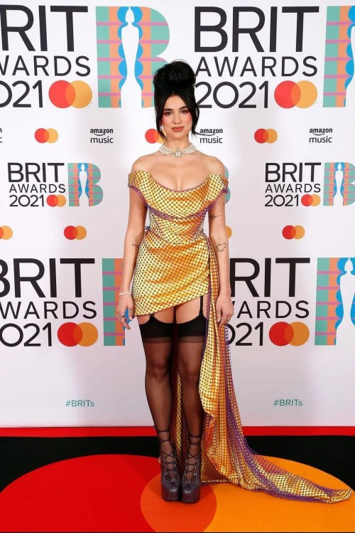 Yay or nay? Dua Lipa attends the BRIT AWARDS 2021 weaeing a Vivienne Westwood outfit - SeenIt
