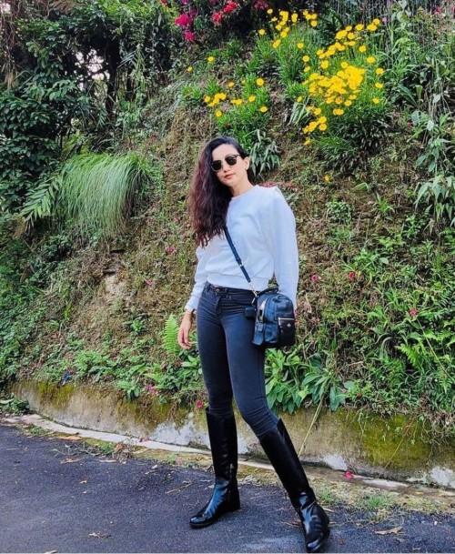Looking for a similar black backpack like Gauhar khan is seen wearing - SeenIt