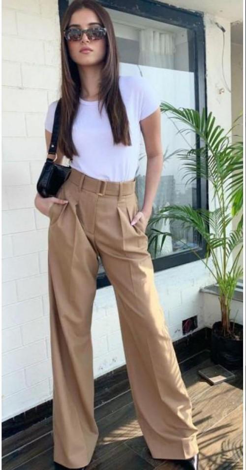 Looking for those similar brown denims please - SeenIt