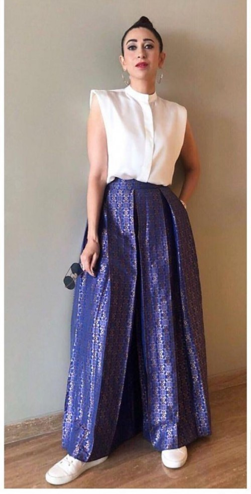 Yay or nay? Karisma Kapoor seen wearing a white blouse and purple silk skirt - SeenIt