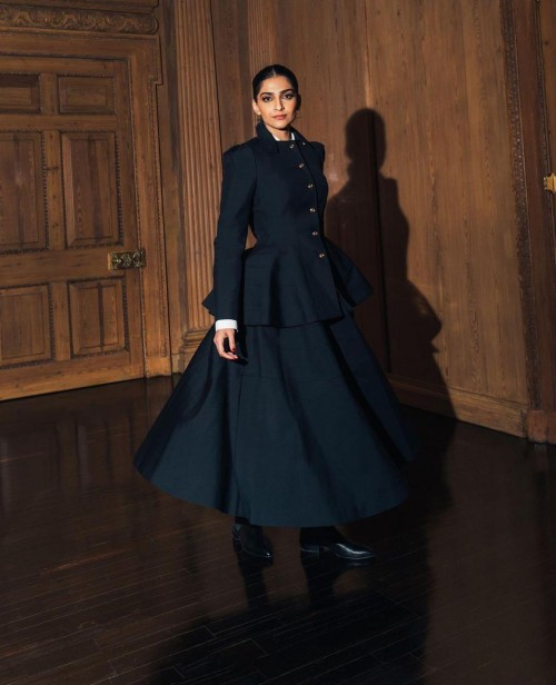 Yay or nay? Sonam kapoor seen wearing a black short peolum blazer with a skirt outfit - SeenIt
