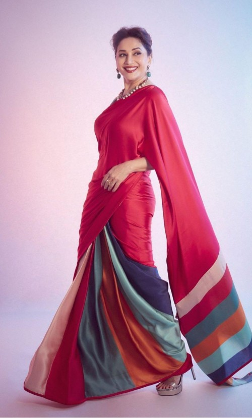 Looking for a similar red saree worn by Madhuri Dixit on the sets of dance deewane - SeenIt