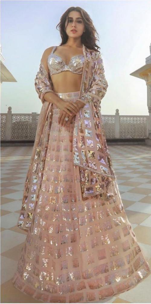 Yay or nay? Sara Ali Khan seen wearing a Manish Malhotra lehenga in gold shimmer - SeenIt