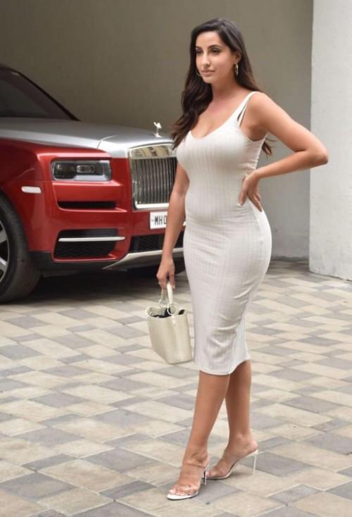 Nora Fatehi's similar ribbed midi bodycon dress please - SeenIt