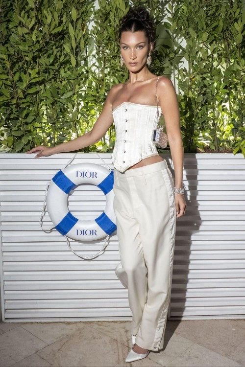 Yay or nay? Bella Hadid attended a Dior dinner wearing slouchy trousers and a corset top, both by Dior - SeenIt