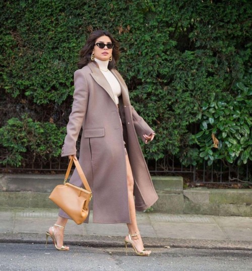 Yay or nay? Priyanka Chopra seen wearing a long over coat with high heels outfit - SeenIt