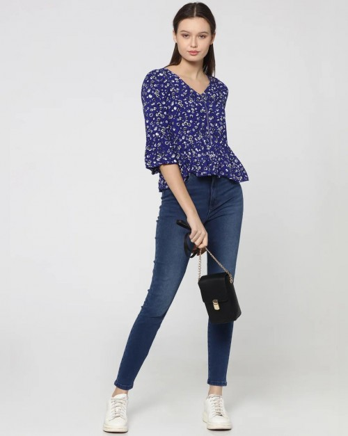 Looking for similar blue top and jeans - SeenIt