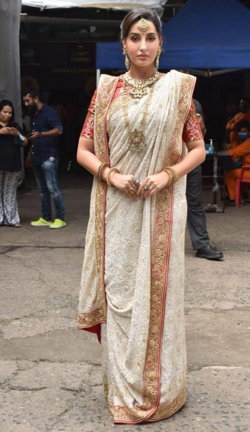 Yay or nay? Nora Fatehi seen wearing a white saree with a golden border - SeenIt
