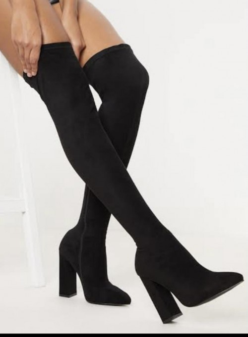 I am looking for a thigh high boots in black - SeenIt