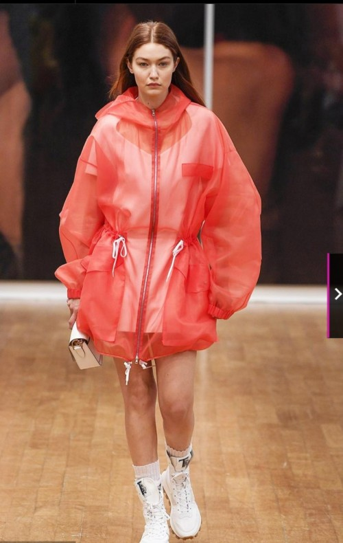 Yay or Nay?  Gigi Hadid appears in a sheer red rain jacket during Tod's Milan Fashion Week show - SeenIt