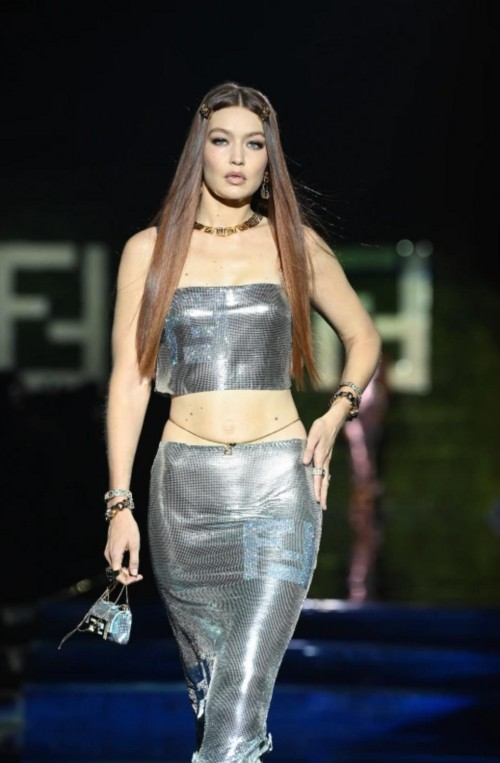 Yay or nay? Gigi Hadid walks the runway at the Versace and Fendi special event during Milan Fashion Week in Italy - SeenIt