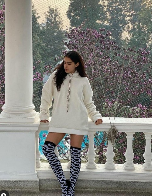 Similar white hoodie and designer boots //sara ali khan - SeenIt