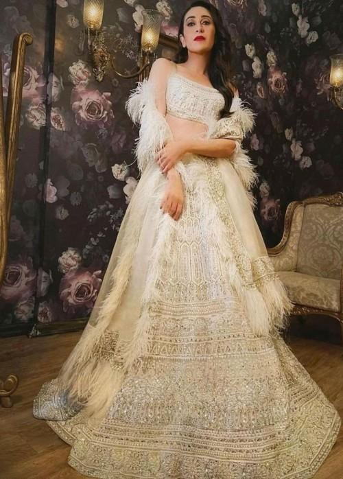 Yay or nay? Karisma Kapoor seen wearing an off white Manish Malhotra lehenga outfit recently - SeenIt