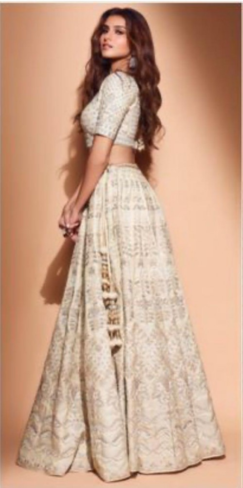 Yay or nay? Tara Sutaria seen wearing  an off white embroidered lehenga outfit by Anita Dongre - SeenIt