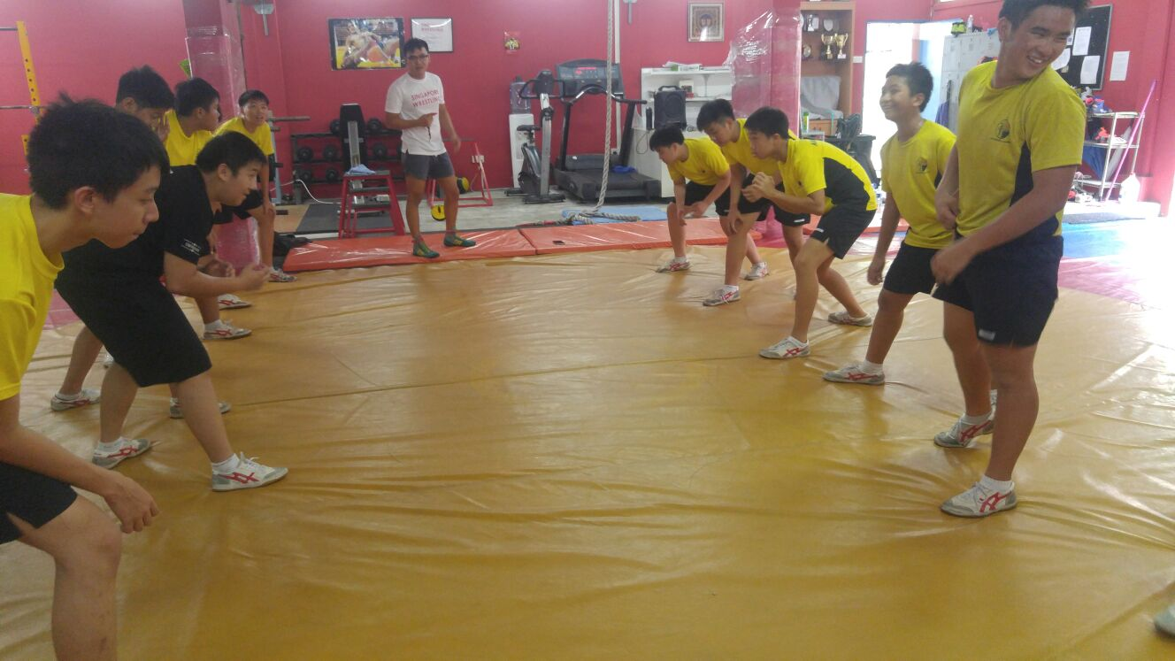 Participants doing wrestling drills