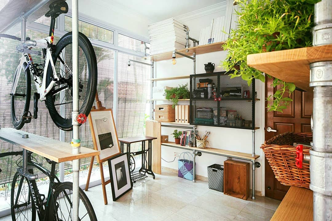 squarerooms-peng-handcrafted-wooden-furniture-workshop-bicycle-creative-shelves-pipes