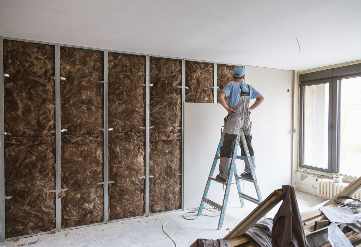 squarerooms-construction-worker-building-wall-drywall-insulation