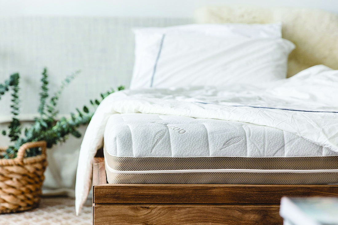 squarerooms-european-bedding-mattress-bed-wooden-white-bedding-bedroom-plant-front-view