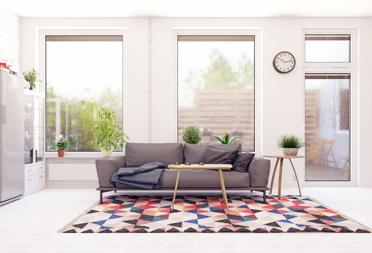 squarerooms-living-room-couch-window-bright-grey-carpet