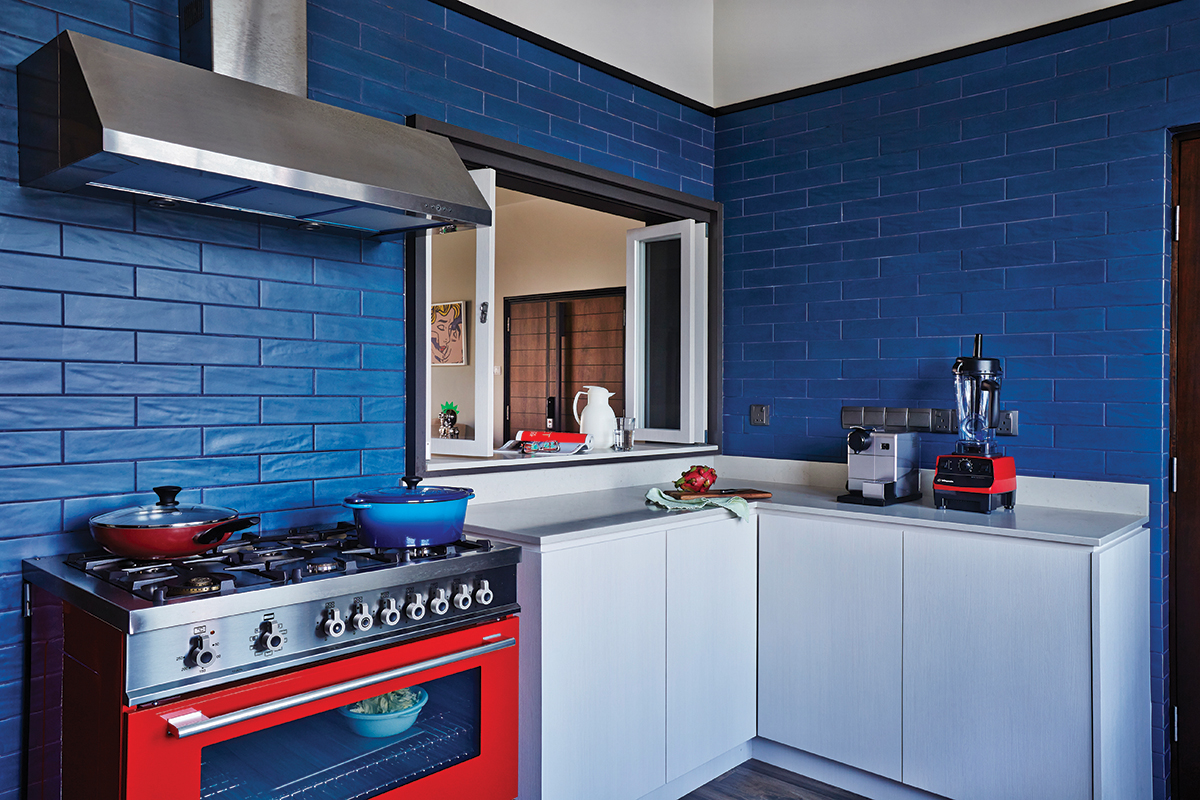 squarerooms-blue-tiles-kitchen-bright-colourful-red-stove