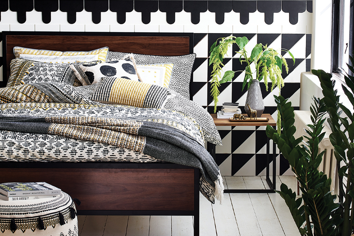 squarerooms-monochromatic-black-white-tiles-bedroom-feature-wall