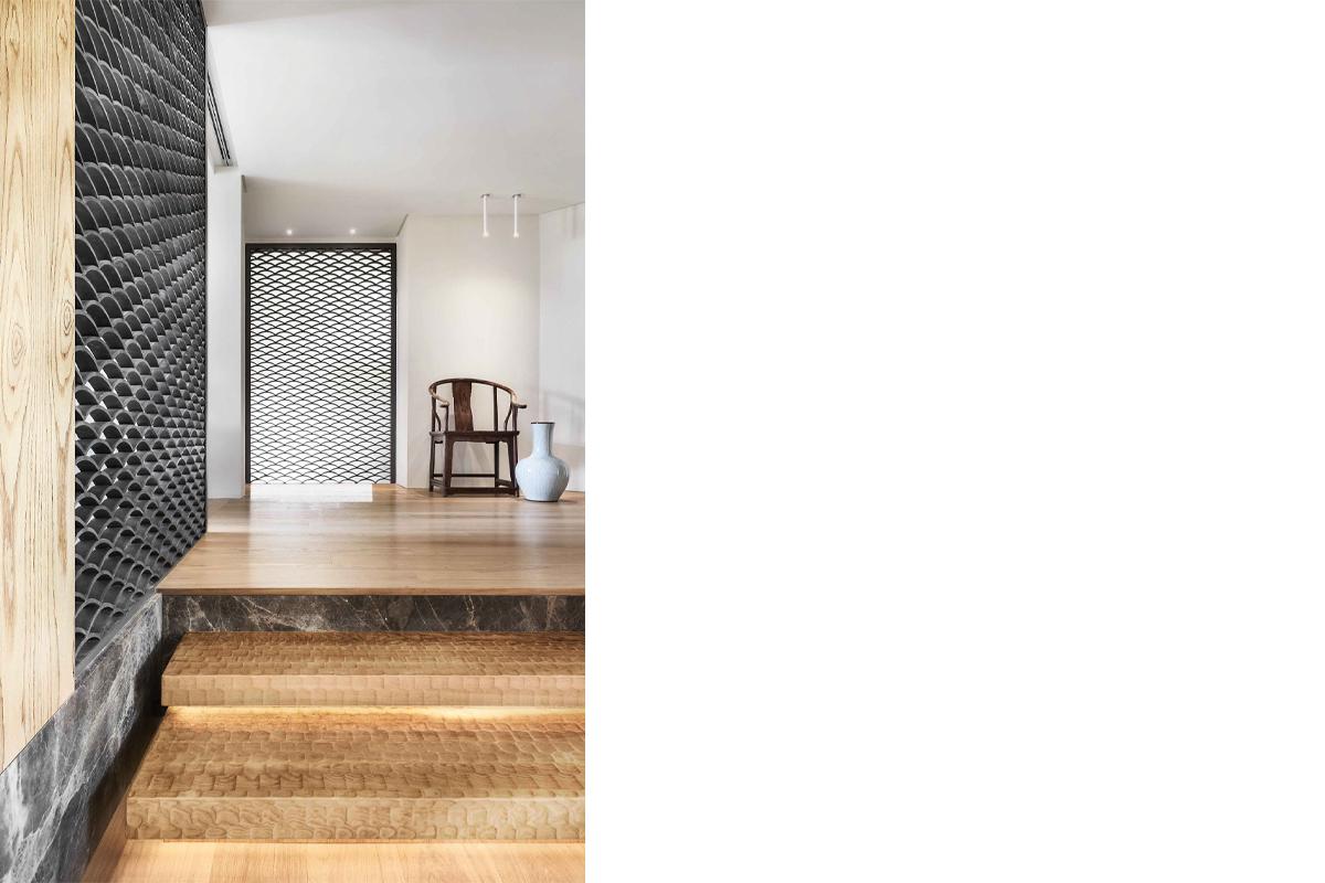 squarerooms-stairs-wooden-floor-metal-tiles-pattern-wall-door-archway