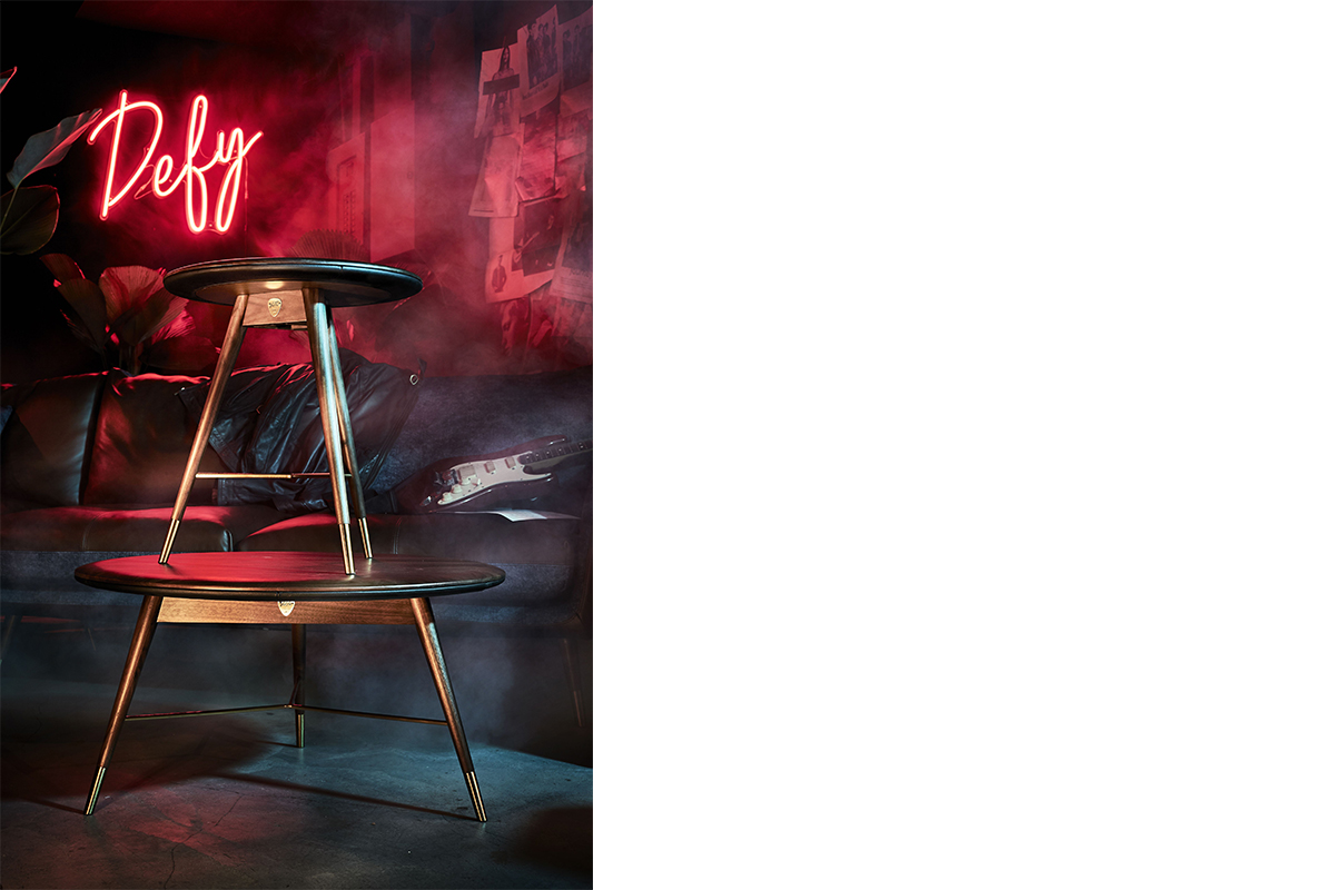 squarerooms-volta-commune-wooden-leather-coffee-table-product-shot-edgy-pink-neon-smoke-lights