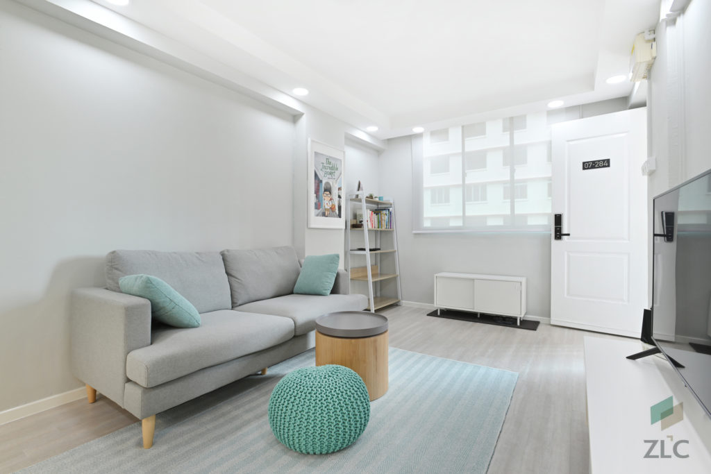 squarerooms-zlc-construction-living-room-grey-couch-pastel-blue-turquoise-cosy-simple-singapore