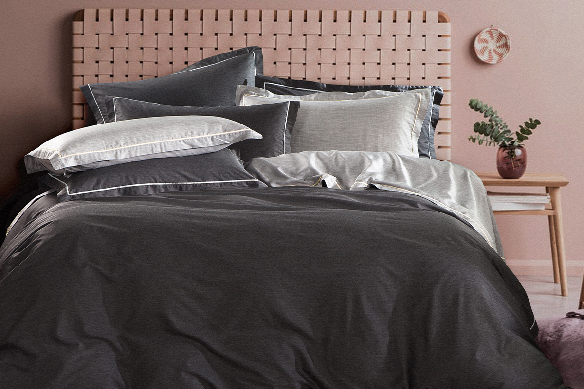 squarerooms-comfort-awards-bedding-hooga-bed-pink-wall-monochromatic-black-grey-sheets