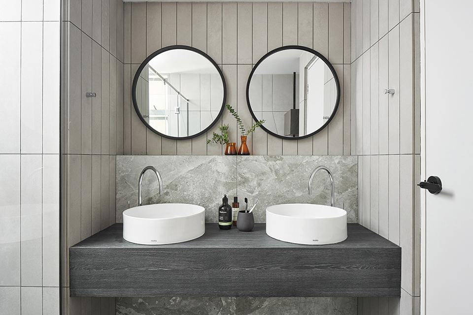 squarerooms studio fortyfour blue curved design condo grey bathroom